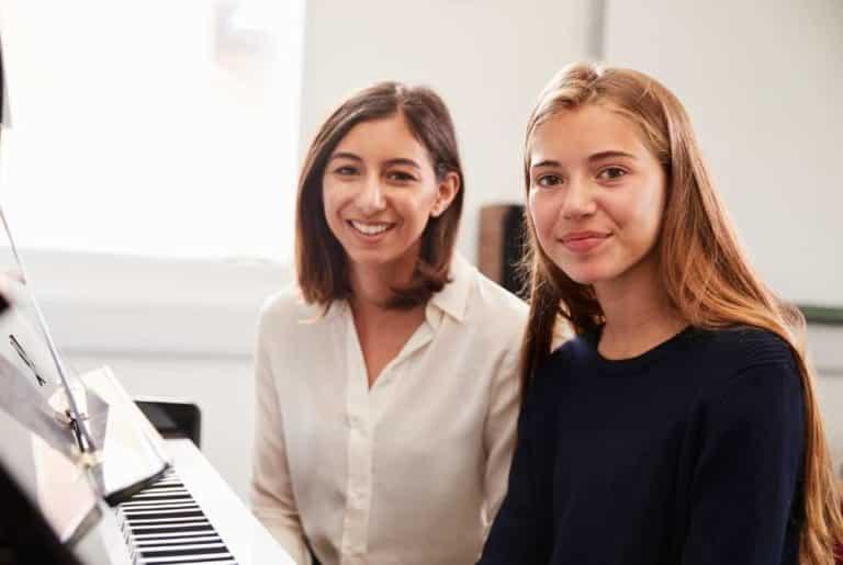 girl taking music lessons